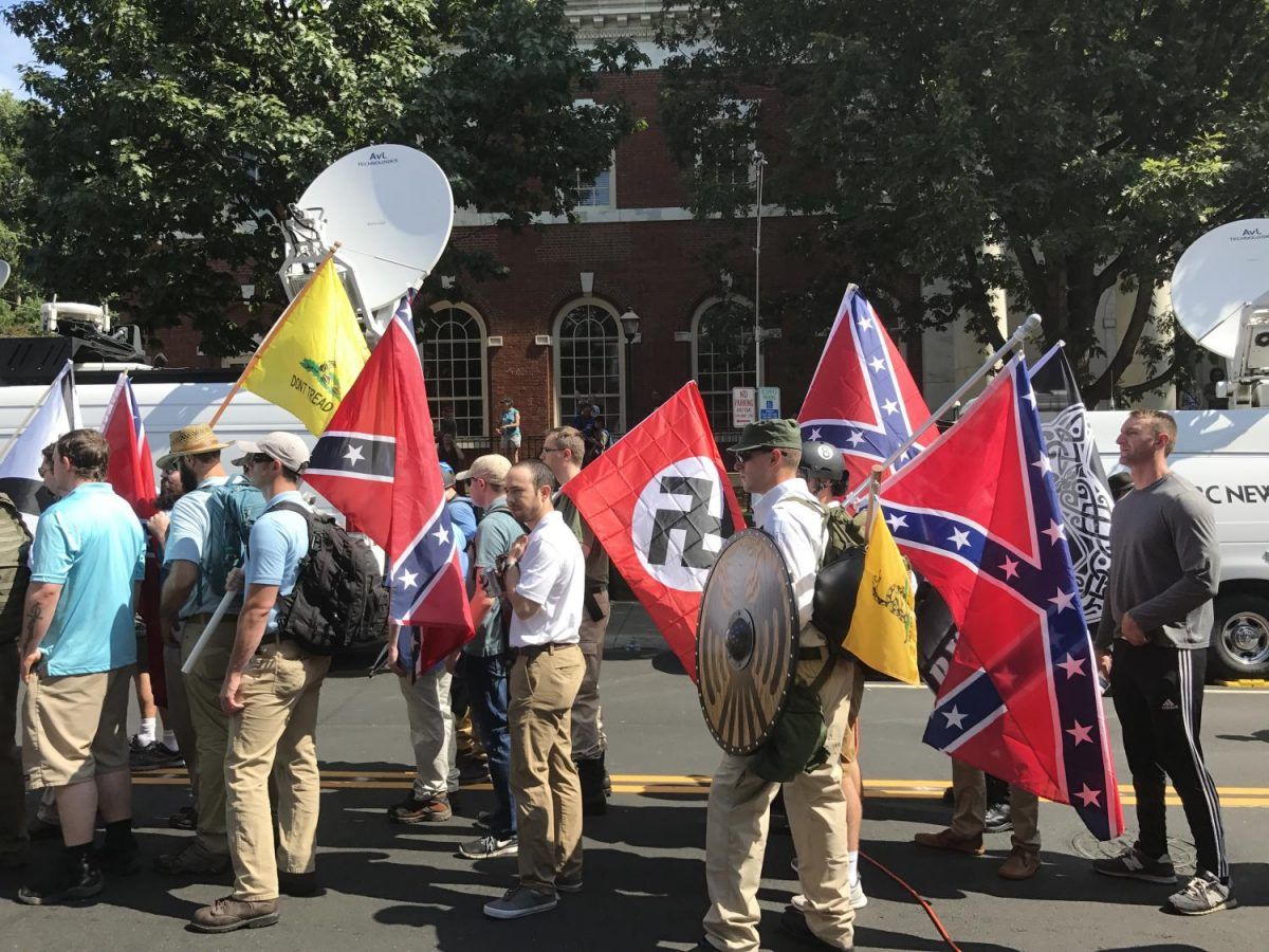 Charlottesville+rally+participants+walk+the+streets+with+confederate+and+swastika+flags%2C+chanting+