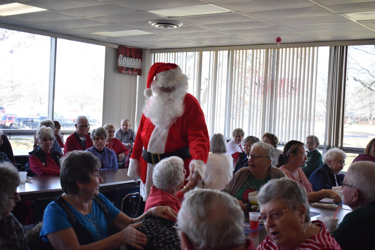 Senior citizen luncheon features Santa; brings joy to students, staff and seniors.