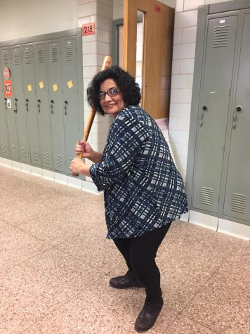 Science teacher Mariely Dawson is seen flexing her language bat in the hallways of Ashland High School. She will start flexing her language bat every Tuesday, approximately halfway through first period.