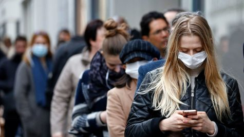 Line of people with some wearing masks because of Covid-19 protocols