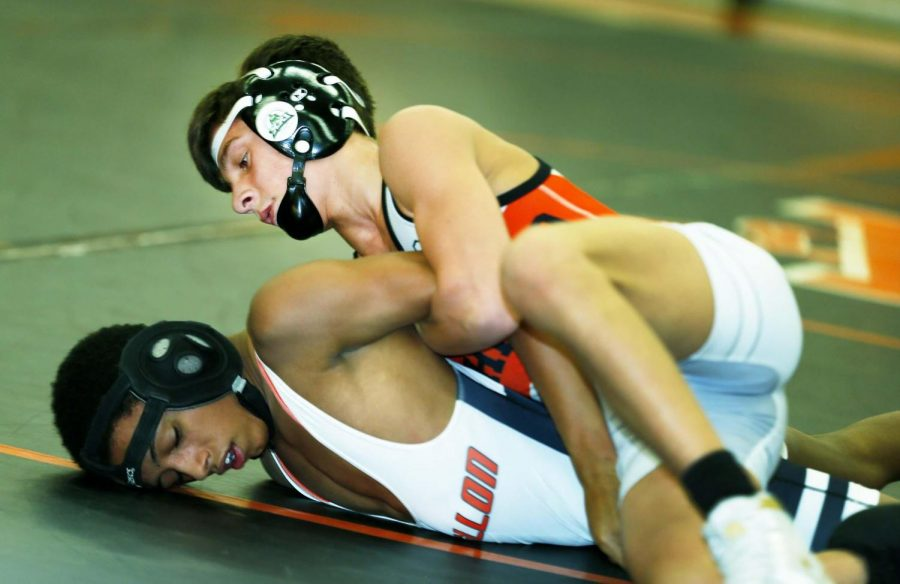 Ashland's Roman P. grapples with Massillon wrestler in 106-pound match up.
